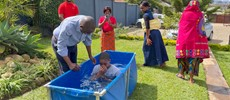Brother Saidi baptizing